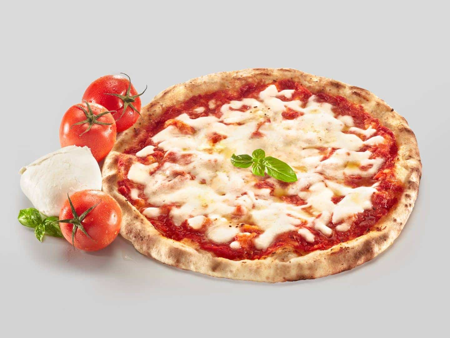 fotografo food still life editoriale pizza margherita surgelata per packaging